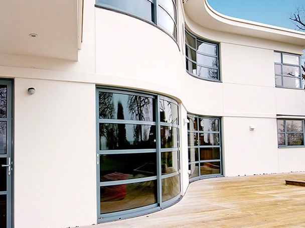 Modern contemporary curved grey aluminium doors and windows on a new built house.