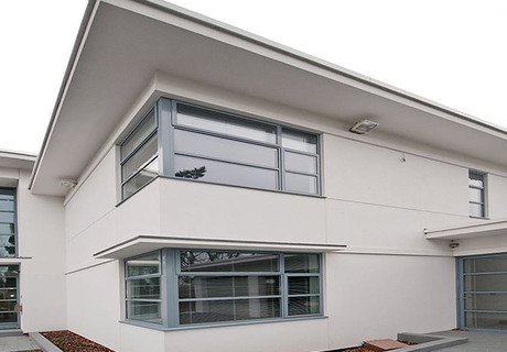 Modern grey aluminium corner bay double glazed windows and co-ordinating door.