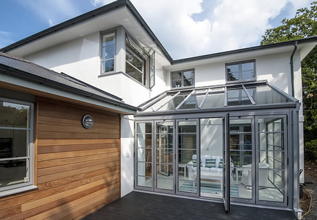 Glass roof on conservatory.  Bi folding aluminuim doors with double traffic doors in centre.   Grey coloured aluminuim windows.