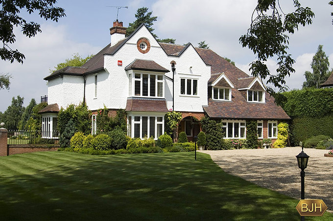 Large edwardian property with white upvc double glazed windows with leaded glass.  Square bay windows. Dormer windows.  Single windows.  Side single square bay window.