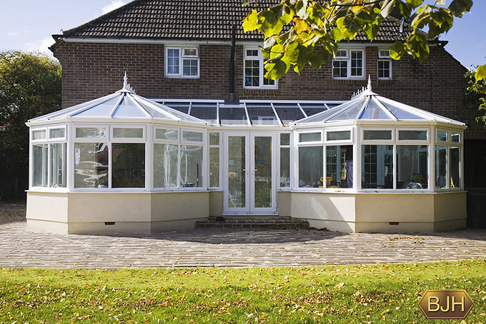 Double Conservatory with central french doors.  White upvc.  Glass roof.  Unusual.