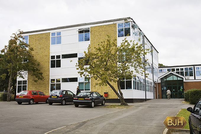 Pvc-u windows and doors to school buildings in Southampton including Blue Tinted Glass. Green Pvc-u high pitched entrance porch with glass doors.
