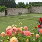 Barton tennis in walled garden with flowers