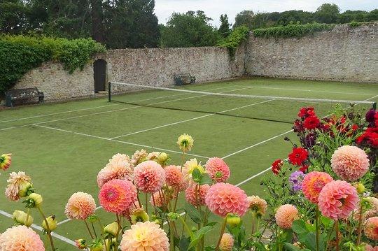 Barton tennis in walled garden with flowers