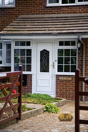 White Pvc-u Porch with white Georgian Bars.