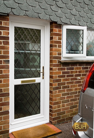 White Pvc-u back door with diamond lead-lights.