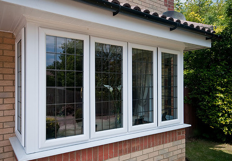 White Pvc-u square bay window with dummy sashes. Featuring rectangular lead lights.