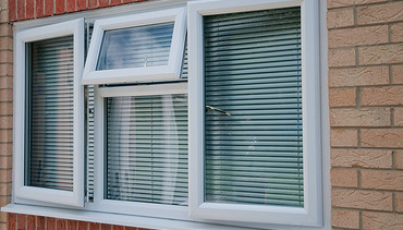 UPVc white window with two openers and one fanlight