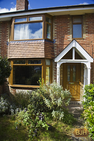 Oak effect Pvc-u windows.  Oak effect composite front door.
