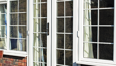 French Doors with flanking windows featuring squares.