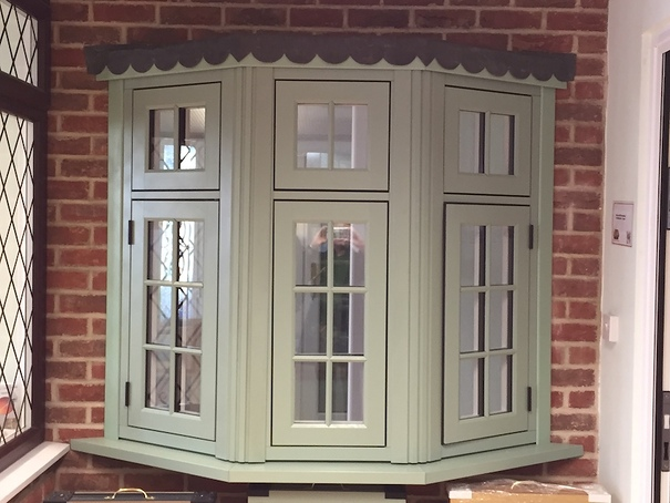 Heritage sculptured pvc u in cream featuring black fancy for Wood effect upvc french doors