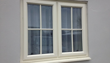 Heritage Grained Pvc-u double glazed window in Cream with square bars.