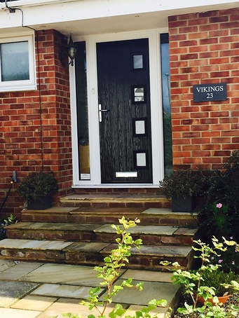 Black Composite front door with side light panels