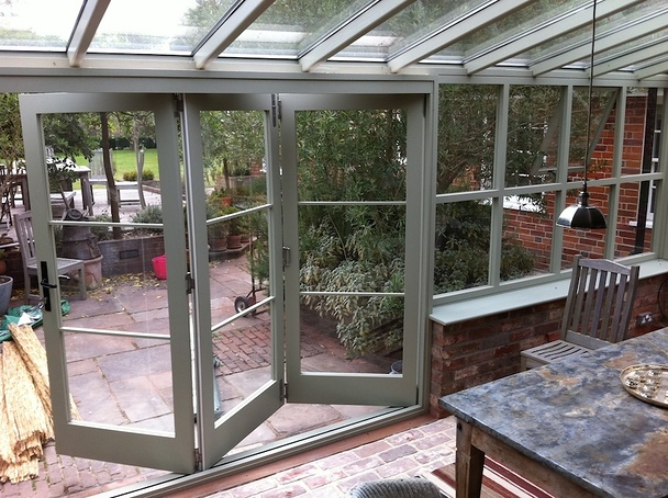 Green hardwood bi folding doors