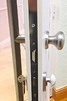 Example of a Slam Lock on a composite door featuring brushed chrome long handle and furniture.