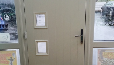Internal photo of a composite front door with letter box.