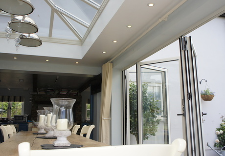 Orangery glass roof.  Recessed lighting within ceiling.