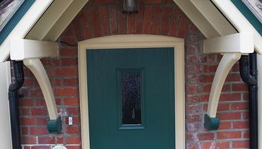 Cream Porch and Green Front Door
