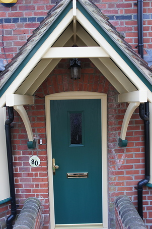 Cream Porch and Green Front Door