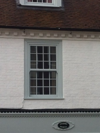 PVC-u vertical sliding sash window in bespoke painted finish.