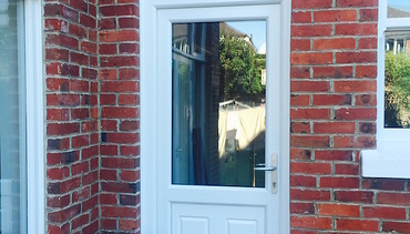 White Pvc-u door featuring top light lite