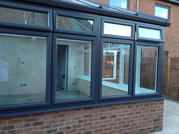 Grey conservatory with Pvc-u in white internally