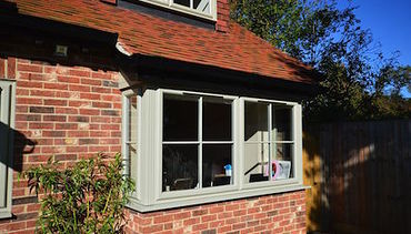 Square Bay Double glazed window in Putty colour Pvc-u colour choice.