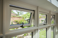 Top light or Fan light sculptured window with monkey tail handle.