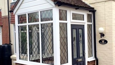 Double Glazed Porch with Blue Composite Front Door