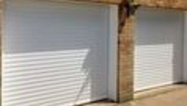 Twin White Roller Shutter Garage Doors