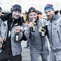 Crews celebrate at the finish dockside