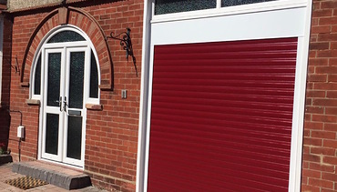 Red roller shutter garage door. Fancy Front doors with frosted glass..jpg