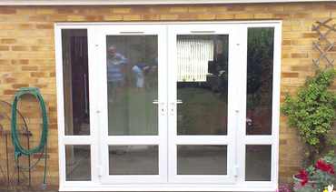 Functional large French doors with flanking glazed panels..jpg