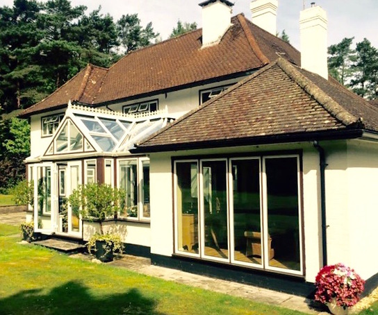 Aluminium & hardwood conservatory and windows.jpg