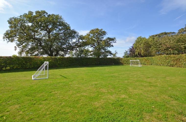 SLB - front lawn garden with goals.jpg