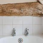 Kiln Cottage oak beam and bath taps.JPG