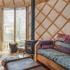 Eric yurt seating and stove.JPG