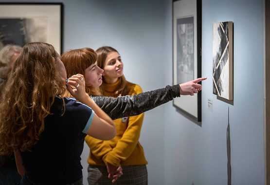 Group pointing at painting in Gallery_Photograph Chris Ison.jpg