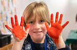 Young-boy-paint-coloured-hands-in-workshop_Chris-Ison-2019.jpg