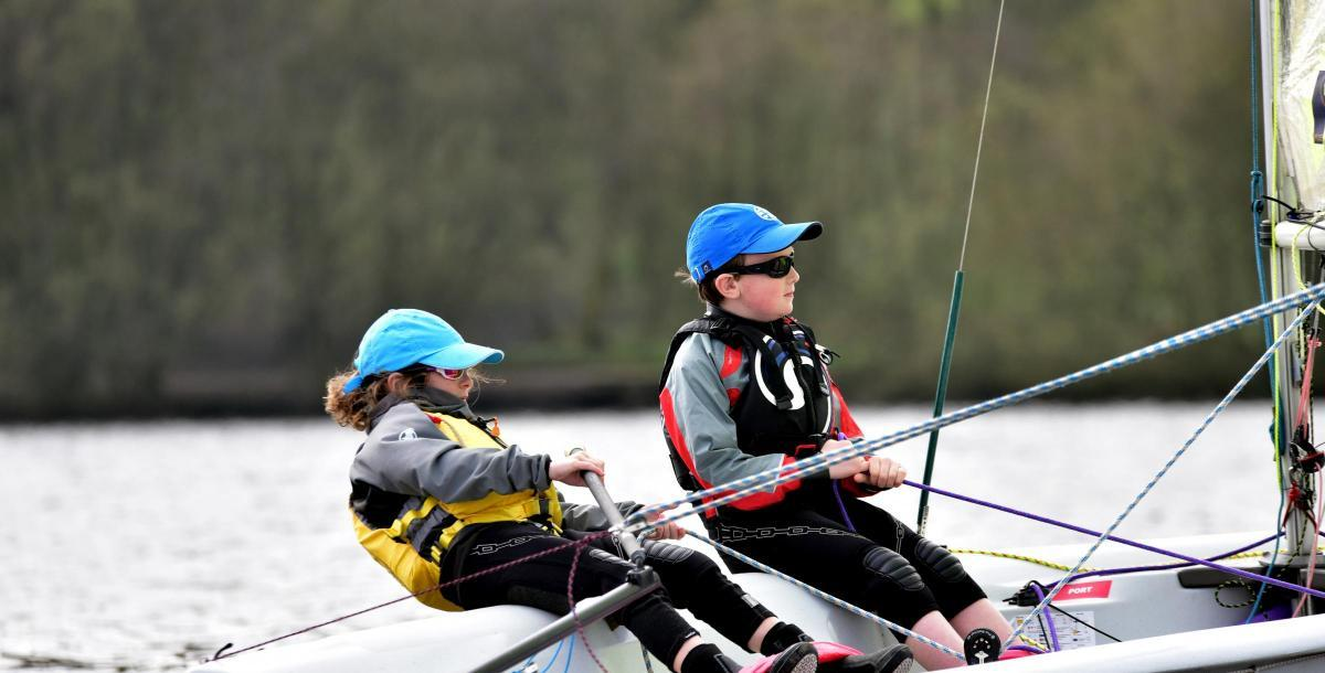 Two children sailing an RS Feva