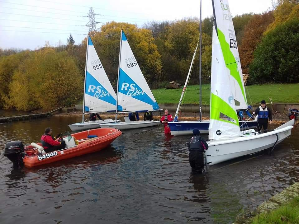 Group of boats being launched by pupils