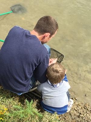 young boy and dad crabbing