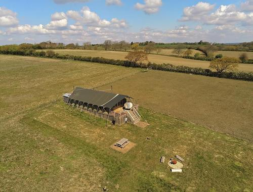 overhead view of Glamping the Wight Way lodge and countryside, West Wight